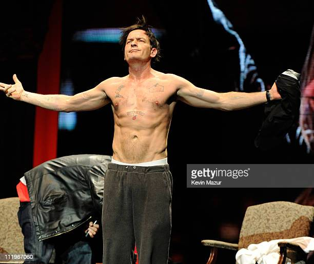 Charlie Sheen speaks on stage during his 'Violent Torpedo of Truth/Defeat Is Not An Option' tour at Radio City Music Hall on April 10 2011 in New...