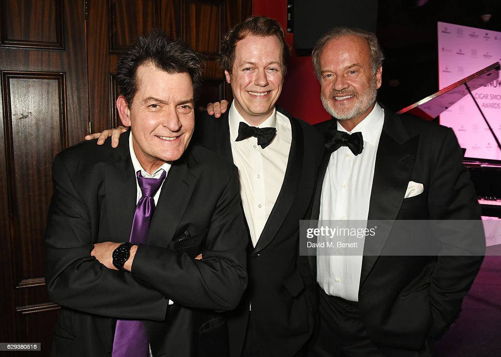 Charlie Sheen, Tom Parker Bowles and Kelsey Grammer attend the Snow Queen Cigar Smoker of the Year awards at Boisdale of Canary Wharf on December 12, 2016 in London, England.