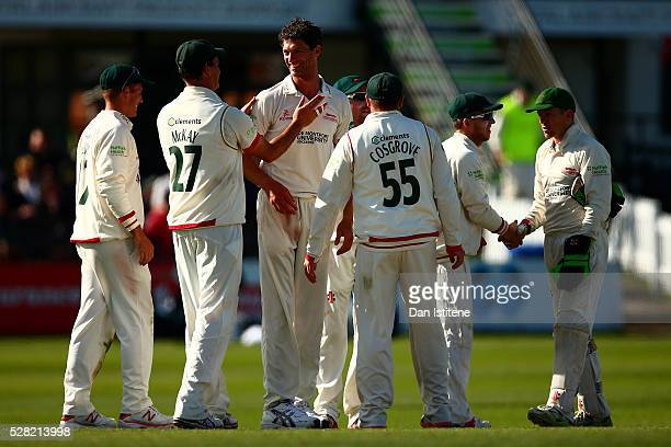 Charlie Shreck of Leicestershire celebrates with his teammates after claiming the wicket of Ben Brown of Sussex during the Specsavers County...