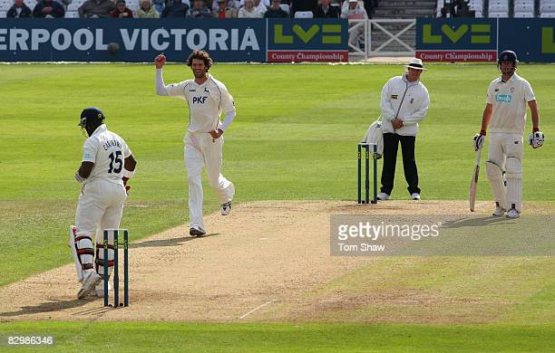 Charlie Shreck of Nottingham celebrates taking the wicket of Michael Carberry of Hampshire during the LV County Championship match between Nottingham...