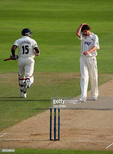 Charlie Shreck of Nottingham holds his head in hands as Hampshire pile on the runs during the LV County Championship match between Nottingham and...