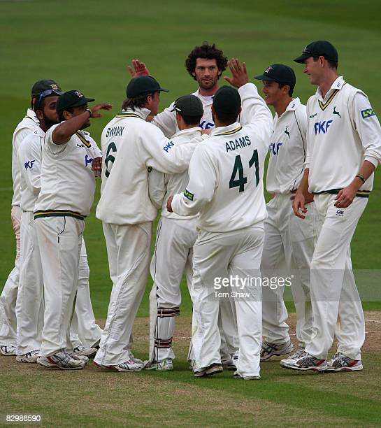 Charlie Shreck of Nottingham is congratulated after taking the wicket of Dimitri Mascarenhas of Hampshire during the LV County Championship match...
