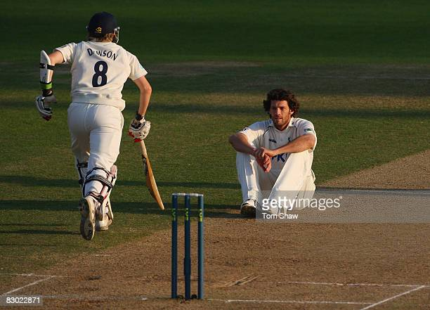 Charlie Shreck of Nottingham looks on from the floor as Liam Dawson of Hampshire piles on the runs during the LV County Championship match between...