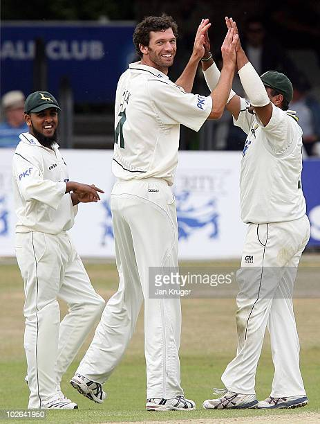 Charlie Shreck of Nottinghamshire celebrates a wicket with team mate Samit Patel during the LV County Championship Division One match between Essex...