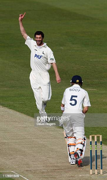 Charlie Shreck of Nottinghamshire celebrates after taking the wicket of Joe Root during the LV County Championship match between Yorkshire and...