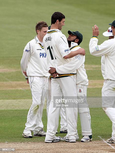 Charlie Shreck of Nottinghamshire celebrates with a hug from Bilal Shafayet of Nottinghamshire after taking the wicket of Kabir Ali of Hampshire...