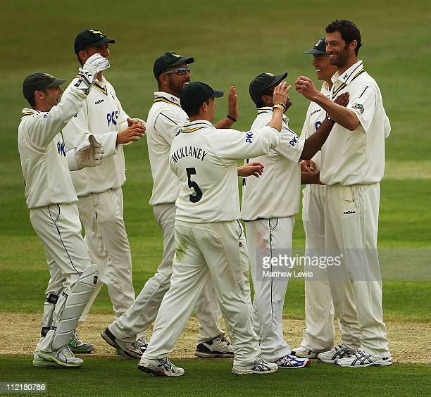 Charlie Shreck of Nottinghamshire is congratulated by team mates after he bowled Nic Pothas of Hampshire during the LV County Championship Division...
