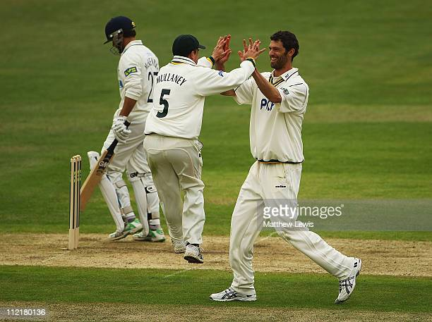 Charlie Shreck of Nottinghamshire is congratulated on the wicket of Johann Myburgh of Hampshire after he was caught by Chris Read during the LV...