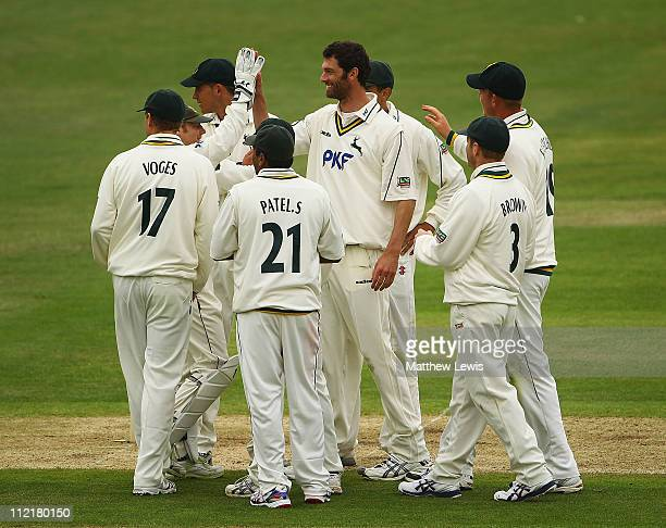 Charlie Shreck of Nottinghamshire is congratulated on the wicket of Neil McKenzie of Hampshire after he was caught by Samit Patel during the LV...
