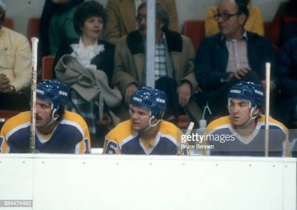 Charlie Simmer Marcel Dionne and Dave Taylor of the Los Angeles Kings known as the Triple Crown Line sit on the bench during an NHL game against the...