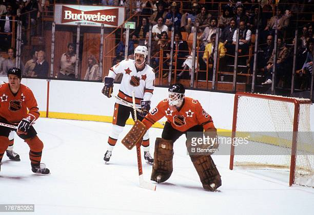 Charlie Simmer of the Wales Conference and Los Angeles Kings waits for the shot as goalie Pete Peeters of the Campbell Conference and Philadelphia...