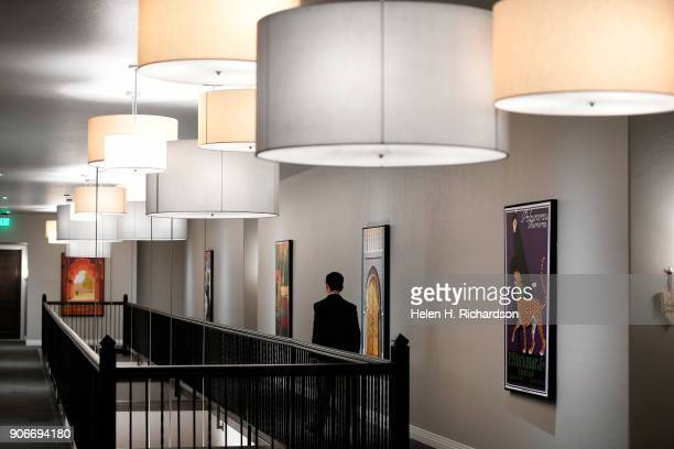 Charlie Soule a real estate broker with Clear Creek walks down the elegantly designed 3rd floor hallway of the new Mirador at Tennyson condominium...