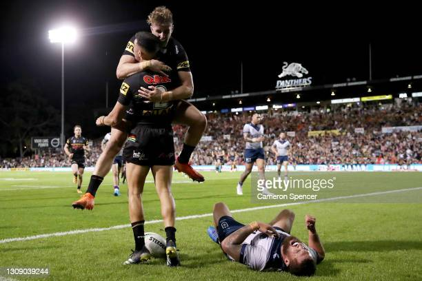 Charlie Staines of the Panthers celebrates with team mates after scoring a try during the round three NRL match between the Penrith Panthers and the...