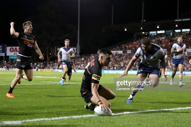 Charlie Staines of the Panthers scores a try during the round three NRL match between the Penrith Panthers and the Melbourne Storm at Panthers...