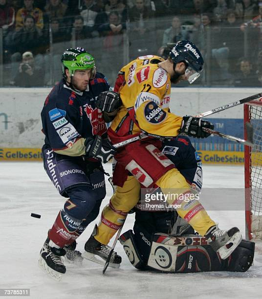 Charlie Stephens of Dusseldorf , Florian Ondruschka and Jean-Francois Labbe battle for the puck l during the DEL Play Off semi final match between...