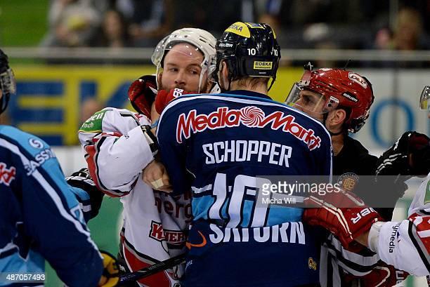 Charlie Stephens of Koeln fights with Benedikt Schopper of Ingolstadt in game six of the DEL final playoffs between ERC Ingolstadt and Koelner Haie...