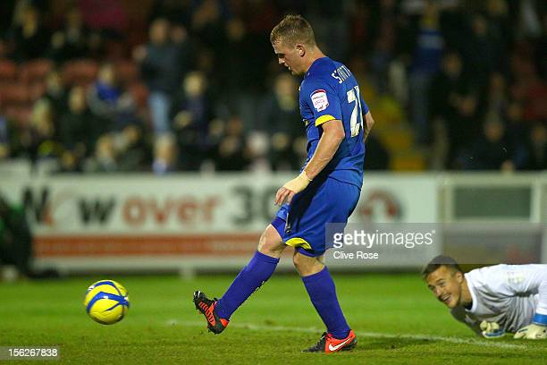 Charlie Strutton of AFC Wimbledon rounds York City keeper Michael Ingham to score during the FA Cup First Round Replay between AFC Wimbledon and York...