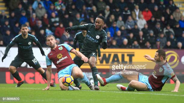 Charlie Taylor and Phil Bardsley of Burnley chase down Raheem Sterling of Manchester City during the Premier League match between Burnley and...