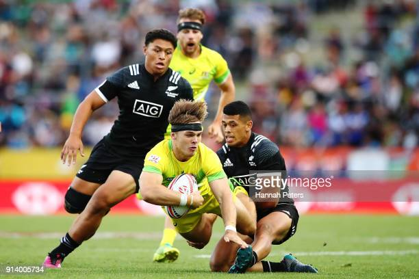 Charlie Taylor of Australia charges forward during the Bronze Medal match between Australia and New Zealand during the 2018 New Zealand Sevens at FMG...