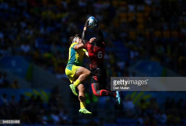 Charlie Taylor of Australia competes for the high ball with Jeffery Oluoch of Kenya during the Rugby Sevens Men's Placing 58th match between...