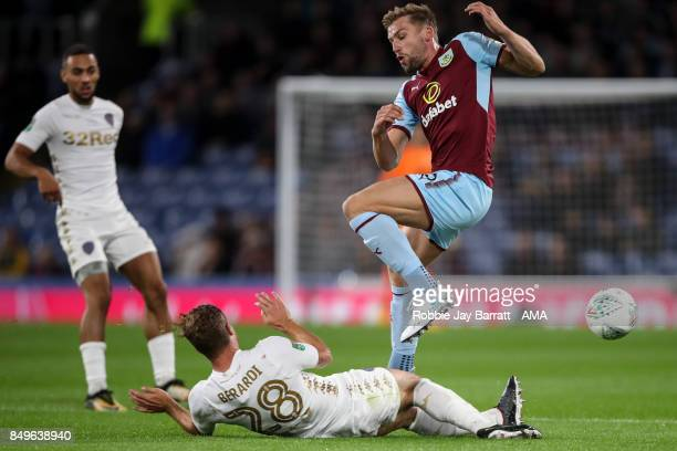Charlie Taylor of Burnley and Gaetano Berardi of Leeds United during the Carabao Cup Third Round match between Burnley and Leeds United at Turf Moor...