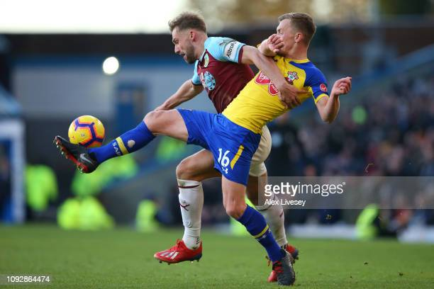 Charlie Taylor of Burnley battles for possession with James WardProwse of Southampton during the Premier League match between Burnley FC and...