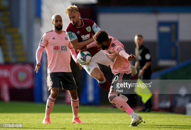 Charlie Taylor of Burnley battles for possession with Jayden Bogle of Sheffield United during the Carabao Cup second round match between Burnley and...