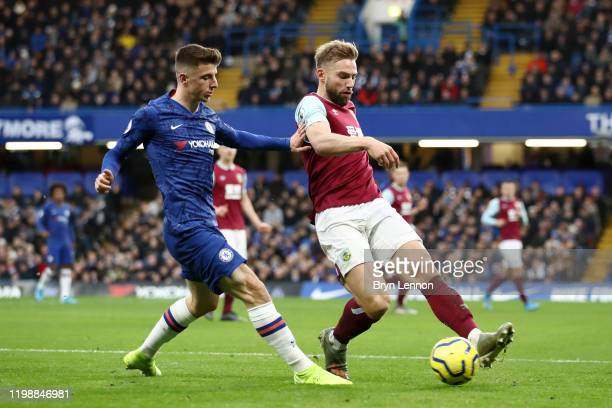 Charlie Taylor of Burnley battles for possession with Mason Mount of Chelsea during the Premier League match between Chelsea FC and Burnley FC at...