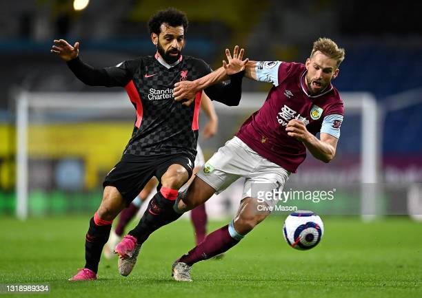 Charlie Taylor of Burnley battles for possession with Mohamed Salah of Liverpool during the Premier League match between Burnley and Liverpool at...