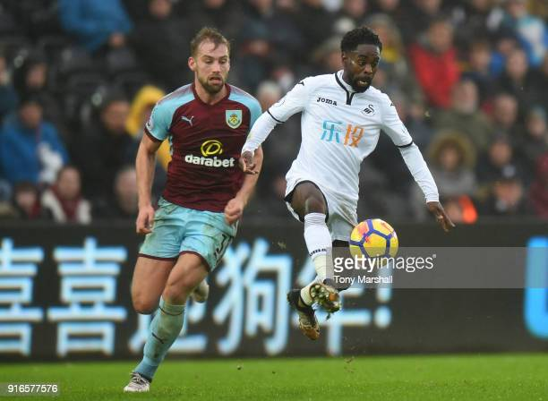 Charlie Taylor of Burnley chases down Nathan Dyer of Swansea City during the Premier League match between Swansea City and Burnley at Liberty Stadium...