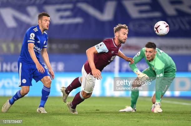 Charlie Taylor of Burnley clears as Nick Pope of Burnley looks on during the Premier League match between Leicester City and Burnley at The King...