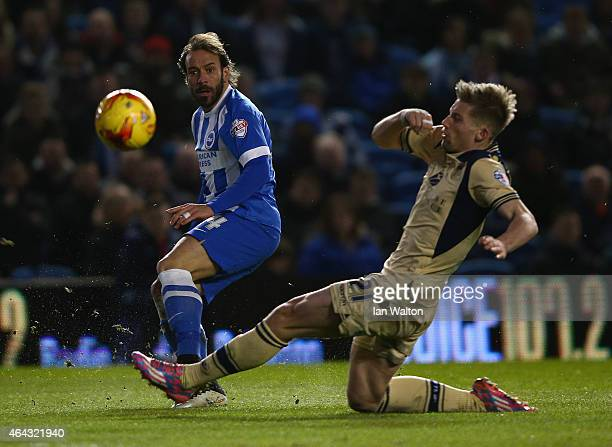 Charlie Taylor of Leeds tries to tackle Inigo Calderon of Brighton Hove during the Sky Bet Championship match between Brighton Hove Albion and Leeds...