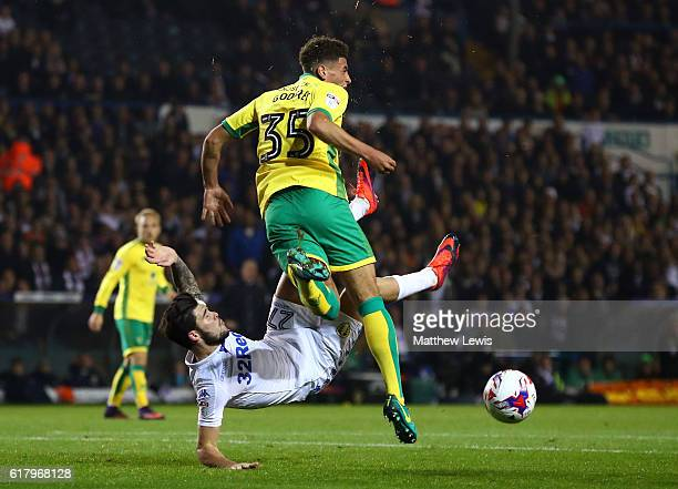 Charlie Taylor of Leeds United and Ben Godfrey of Norwich City battle for possession during the EFL Cup fourth round match between Leeds United and...