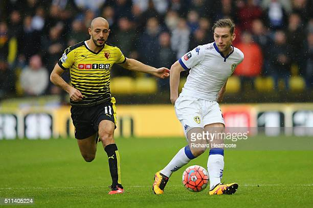 Charlie Taylor of Leeds United and Nordin Amrabat of Watford compete for the ball during the Emirates FA Cup fifth round match between Watford and...