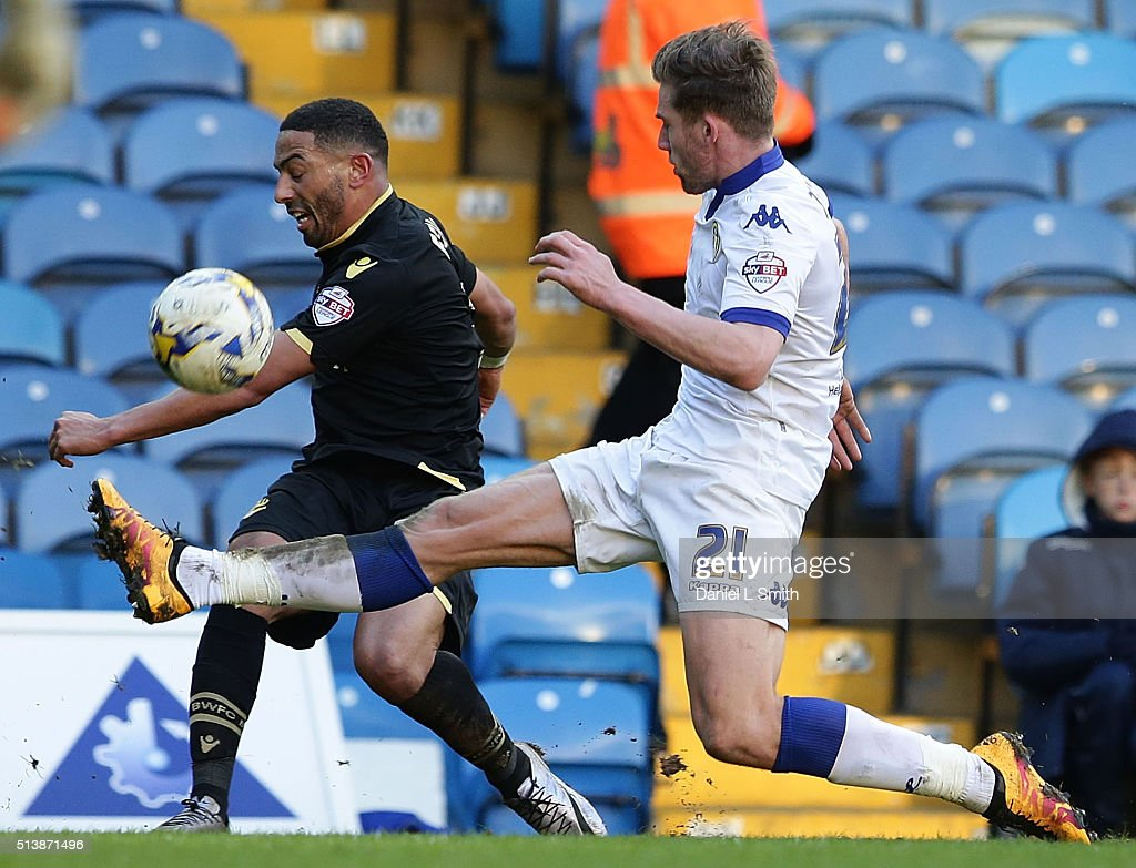 Charlie Taylor of Leeds United FC under presser from Liam Feeney of Bolton Wanderers FC during the Sky Bet Championship League match between Leeds United and Bolton Wanderers, at Elland Road Stadium on March 5, 2016 in Leeds, United Kingdom.