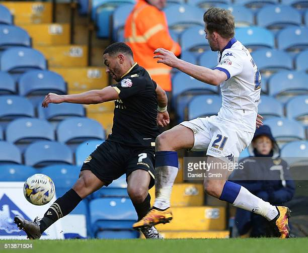 Charlie Taylor of Leeds United FC under presser from Liam Feeney of Bolton Wanderers FC during the Sky Bet Championship League match between Leeds...