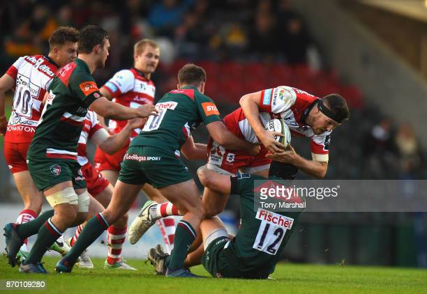 Charlie Thacker of Leicester Tigers tackles Jake Polledri of Gloucester Rugby during the AngloWelsh Cup match at Welford Road on November 4 2017 in...