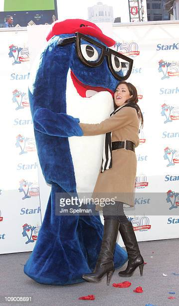 Charlie the Tuna and Jillian Harris attend Charlie the Tuna's 50th birthday celebration at Military Island Times Square on February 11 2011 in New...