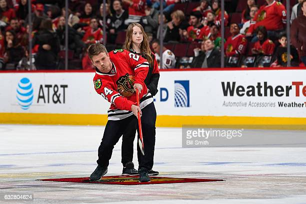 Charlie Tilson center fielder for the Chicago White Sox shoots the puck in between periods of the game between the Chicago Blackhawks and the...
