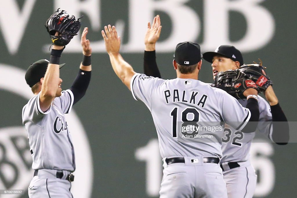 Charlie Tilson #22, Daniel Palka #18 and Trayce Thompson #32 of the Chicago White Sox react after a victory over the Boston Red Sox at Fenway Park on June 08, 2018 in Boston, Massachusetts.