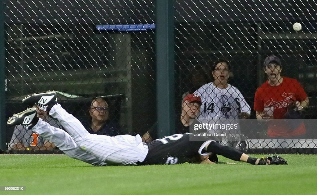 Charlie Tilson #22 of the Chicago White Sox dives in vain for a ball hit by Matt Carpenter of the St. Louis Cardinals in the 6th inning at Guaranteed Rate Field on July 11, 2018 in Chicago, Illinois.