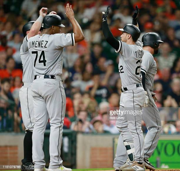 Charlie Tilson of the Chicago White Sox is congratulated at home plate by Eloy Jimenez James McCann and Yonder Alonso after hitting a grand slam in...