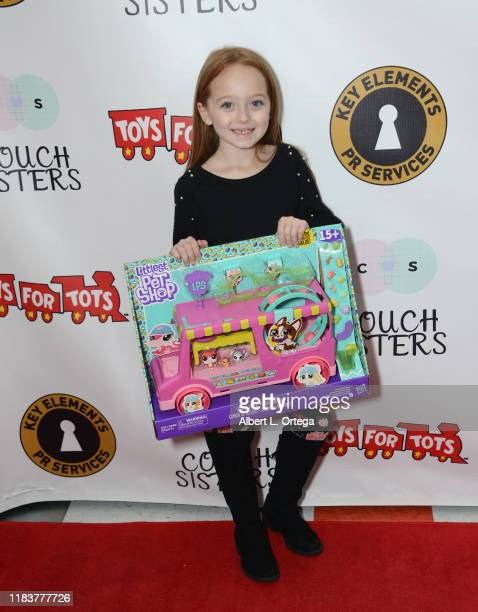 Charlie Townsend attends The Couch Sisters 1st Annual Toys For Tots Toy Drive held onNovember 20 2019 in Glendale California