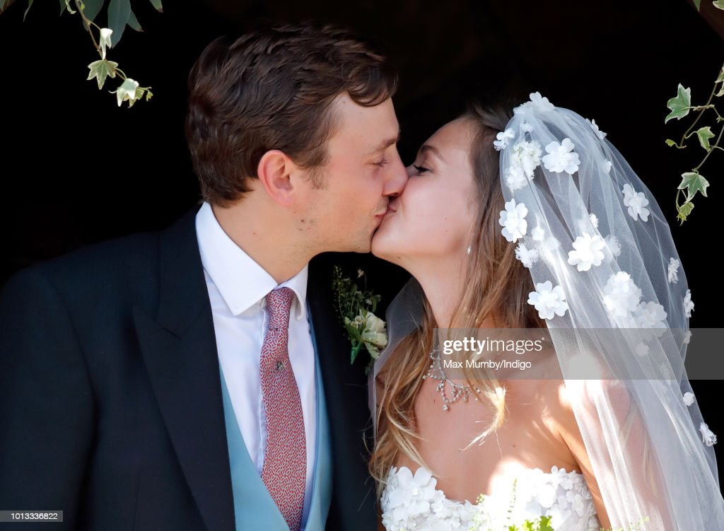 Charlie van Straubenzee and Daisy Jenks kiss as they leave the church of St Mary the Virgin after their wedding on August 4, 2018 in Frensham, England. Prince Harry attended the same prep school as Charlie van Straubenzee and have been good friends ever since.