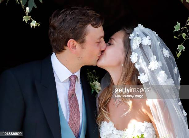 Charlie van Straubenzee and Daisy Jenks kiss as they leave the church of St Mary the Virgin after their wedding on August 4, 2018 in Frensham,...
