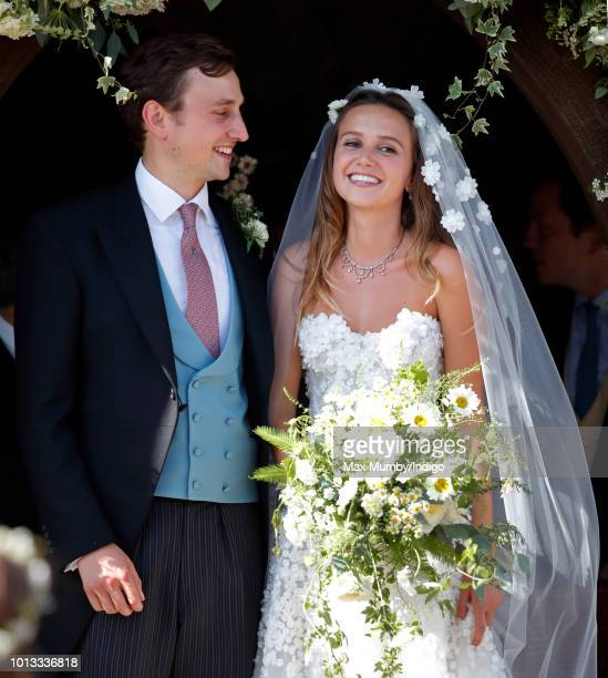Charlie van Straubenzee and Daisy Jenks leave the church of St Mary the Virgin after their wedding on August 4, 2018 in Frensham, England. Prince...