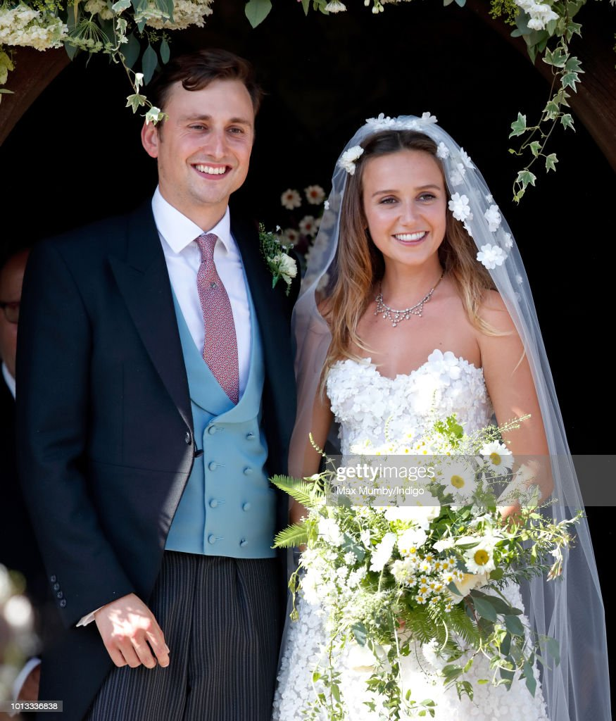 Charlie van Straubenzee and Daisy Jenks leave the church of St Mary the Virgin after their wedding on August 4, 2018 in Frensham, England. Prince Harry attended the same prep school as Charlie van Straubenzee and have been good friends ever since.
