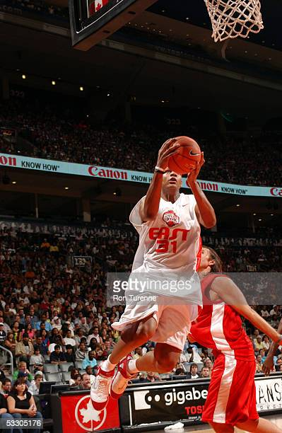 Charlie Villaneuva of the East lays one in ahead of Steve Nash of the West during the Steve Nash Foundation Charity Classic on July 29 2005 at the...