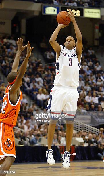 Charlie Villanueva of the Connecticut Huskies shoots a jumper over Louie McCroskey of the Syracuse Orangemen on February 2 2004 at the Hartford Civic...