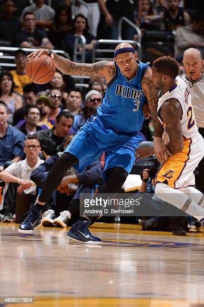Charlie Villanueva of the Dallas Mavericks handles the ball against Dwight Buycks of the Los Angeles Lakers on April 12 2015 at Staples Center in Los...